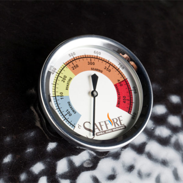 A temperature gauge showing heat ranges for smoking, roasting and searing, for premium kamado cooking