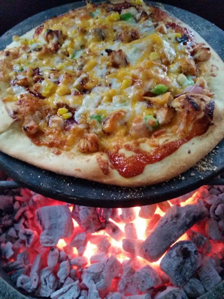 Homemade Pizza Grilling on a Pizza Stone
